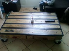 Coffee table made with recycled EPAL pallet and metal.