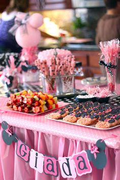 Minnie Mouse party: Giada is 2! this party is perfect, so many good ideas!! polka dot balloons just from adding white dots, a cookie bar, homemade piñata and more!