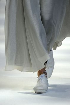 Yohji Yamamoto  ..there is a flow ..that is dream like. .in a look that is  just right with the simple canvas shoes..
