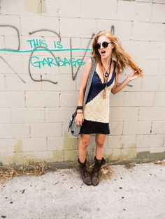 I thought this was funny for some reason[Rachel Arielle is a grunge goddess in her Steve Madden lace-up boots.]