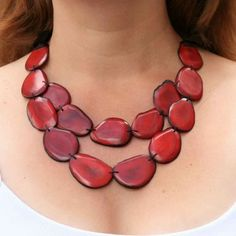 A red necklace will always be in the spotlight, you'll feel bright and confident as red such an emotionally rich color. Buy now! $58.00 http://www.artisansintheandes.com/beaded-necklaces-bib-necklace-chunky/beaded-necklaces-red-tagua-slice