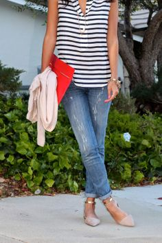 Pair a striped blouse and a pair of boyfriend jeans for a sweet summery nautical look.