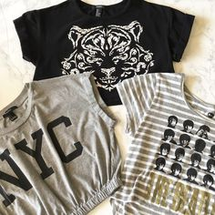 """Bundle of 3 Crop Tops  Cute crop top bundle   1. Black with cuffed sleeves and white tiger face print - only worn once 2. Grey cuffed sleeves with black NYC print and elastic gathered waist 3. Grey and White  striped high low crop with Beatles pic and """"The Beatles"""" in gold shimmer print  All in grey condition maybe worn twice and hung to dry. Forever 21 Tops Crop Tops"""