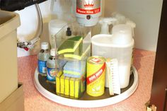 Kitchen Sink Organization - put them on a spinner to maximize space and make it easy to grab what you need