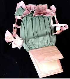"""1850 sewing case, Pink  & green silk, 9"""" long x 4"""" wide x 2.5"""" wide at bottom of pink needle case.  Green silk pounch lined with pink silk, pink drawstring ribbons.  Found in a covered basket with other sewing items."""