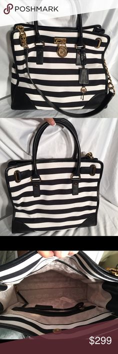Michael Kors Black & White Striped LG Hamilton Michael Kors Black & White Stripe Large Hamilton with Gold details. There are no markings or imperfections that i can find. 14 inches wide X 5.5 inches deep X 13 inches high. Michael Kors Bags