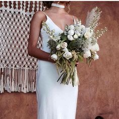 """""""Just casually standing here, waiting for my man"""" ... Adore this shot of our ARLO silk dress and CHASE choker styled with the most amazing bouquet. Can't wait to see this shoot from @lovestoned__ #BLANCbyGLL #wesaluteyou #graceloveslace"""