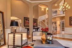 Formal living room with 3 column arch ways #realestate #greatroom