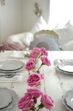 Great antiqued white table and of course lovely pink roses