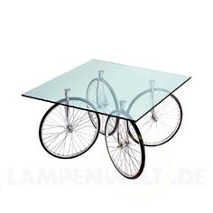 This unique table design by Gae Aulenti called The Fontana Arte Tour Table really surprises me. I am not a cyclist or a lover of the said sport but the table with four-wheel bicycle as legs is awesome. Weird Furniture, Unique Furniture, Furniture Design, Glass Furniture, Table Furniture, Rolling Table, Design Tisch, Used Bikes, Contemporary Dining Table