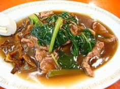 Singapore Beef Hor Fun (Cantonese) thick rice noodles cooked in a thick broth with beef and green vegetables.   Recipe for Beef Hor Fun...