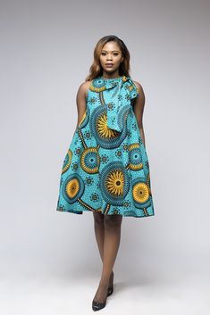 Chibi Dress is part of eye-makeup - sneakers or dress it up with a pair of high heels and a belt to accentuate the waistline 2 side pockets cotton wax 38 inches long Loose fit Fully lined Shoulder selftie bow Doesn't come with the belt or headwrap African Bridesmaid Dresses, Short African Dresses, African Print Dresses, African Prints, Short Dresses, African Dress Designs, Casual Dresses, African Fashion Ankara, Latest African Fashion Dresses