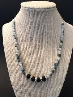 Black and white crystal necklace is made using two different colors of crystals white and black. Measure: 18 inch