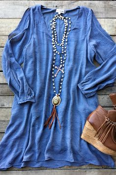 long sleeve dress with a slit in the sleeves.