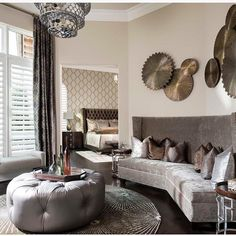 Wall paper, copper tones, velvet couch, tufted ottoman... All that's trending in 2016 in one picture. By Dallas Design Group ... - Interior Design Ideas, Interior Decor and Designs, Home Design Inspiration, Room Design Ideas, Interior Decorating, Furniture And Accessories