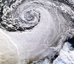Looking south across the southern tip of Greenland, this satellite image shows an enormous cloud vortex spiraling over the northern Atlantic ocean on January 26, 2013. An example of the powerful convection currents in the upper latitudes, these polar low cyclones are created when the motion of cold air is energized by the warmer ocean water beneath.