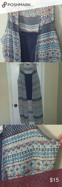 Beautiful vest 47 inches long  worn twice practically new. New Look Tops