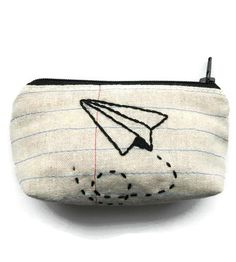 Paper Airplane Zipper Pouch | For storing credit cards, business cards and any other little thing that needs a home, this nifty pouch is the bag for the job. It's fashioned from repurposed denim and natural cotton, stitched with notebook lines and then carefully embroidered with a paper airplane.