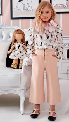 """""""I wanted to reproduce the key features of the women's collection in a Mini-Me version to let girls dress like their mums"""", says the designer. """"I believe in a true blend of colour, imagination and beauty. Even shopping can become a time for playing and bonding""""."""