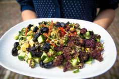 cucumber and purple sprouting broccoli salad with sundried tomato and sesame seed dressing