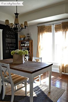 Love the table, chandelier, and wall with writing script. And curtains if they were smocked at the bottom, not top. :)