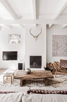Neutral living room with rustic coffee table and deer skull | Domino #nails #nailart #followback