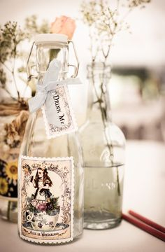 Love the idea of having these decorative Alice themed water bottles on my vintage table