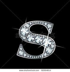 """A stunningly beautiful """"S"""" set in diamonds and silver."""
