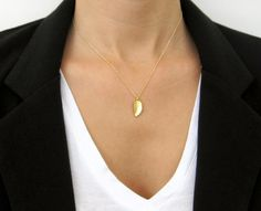 Gold Leaf Necklace / Small Delicate Necklace / 14k Gold Filled Chain / Simple Gold Necklace / Everyday Necklace Gold. $32.00, via Etsy.