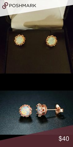 18k Rose Gold Fire Opal studs 18k Rose Gold Fire Opal studs. A crown-like setting plated in trendy rose gold enhances the pretty look and feminine appeal of these fire opal earrings.  Total carat weight: 2.00 CTW Earring diameter: 0.3?  No tags. New in box Jewelry Earrings