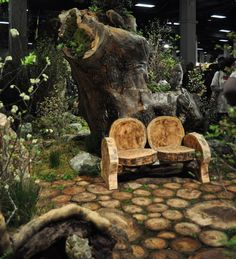 This is a shot from the Boston Flower and Garden show, but I love some of the ideas for a preschool playground if only I had resources and expertise.  The bench, awesome and the walkway from logs cut crossways and the giant treestump -I remember playing on such a one as a kid.