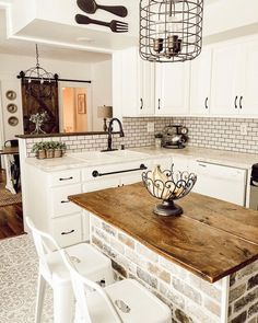Rustic Kitchen Islands You'll Want to Try - - Add a little extra counter space that's both functional and beautiful with a rustic kitchen island that will easily become the hardest working piece in your kitchen. Rustic Kitchen Design, Farmhouse Kitchen Decor, Kitchen Dining, Rustic Farmhouse, Kitchen Sinks, Rustic Table, Kitchen Layout, Farm House Kitchen Ideas, Half Wall Kitchen