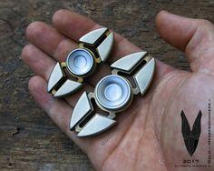 Fidget Spinner - gold und messerschmiede
