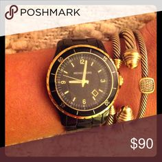 Black & Gold Michael Kors Watch Stylish MK watch in black with gold accents. Gently used and a perfect addition to anyone's jewelry box! Michael Kors Accessories Watches
