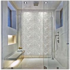 White brick groutless Mother of pearl shower tile.  https://www.subwaytileoutlet.com/products/White-Brick-Groutless-Pearl-Shell-Tile.html#.VZG02PlViko
