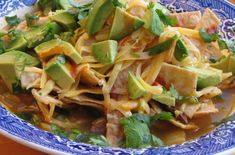 Tortilla Soup - LOVED this - made a few changes: - added 1 can of 28 oz crushed tomatoes to chicken broth - added 1/2 tsp cayenne pepper - simmered for 20-30 minutes after adding chicken.