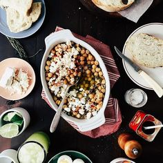 Olive oil braised chickpeas and capers with feta and crusty bread by @joythebaker. Yum!