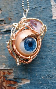 Blinking Eyeball and Amethyst Pendant  Sterling by Magickwrapper, $90.00