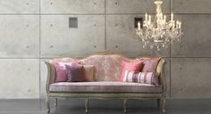 Wrap this gorgeous pink sofa & chandelier up, I'm taking them home with me.