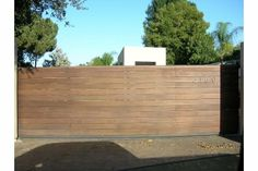 contemporary wooden driveway gates http://www.pinterest.com/avivbeber3/contemporary-garage-doors-gates/