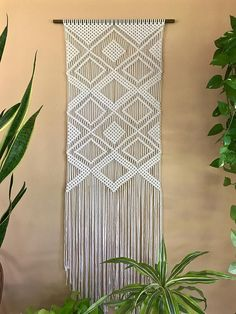 This large macrame wall hanging was made from 3mm natural white cotton rope and hangs from a hand stained wooden dowel. Features a geometric diamond pattern. A unique piece that is sure to add texture and interest to any room! Would make an amazing gift! Wooden dowel is 24, macrame measures approx. 20 wide by 64 long. This item is READY TO SHIP! ✦ Shop Dowel Wall Hangings ✦ www.etsy.com/shop/BermudaDream?section_id=18034902 ✦ Shop Brass Ring Wall Hangings ✦ www.etsy.com...