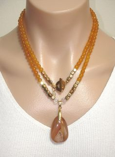 Ashira Golden Yellow Jade Gemstone Necklace and Hand Selected Soft Carnelian Druzy Pendant with Gold Filled Toggle. $225.00, via Etsy.