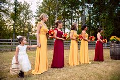 Marron Pines The beautiful bridesmaids with the flower girl during the outdoor wedding ceremony. ::Amanda + Jon's naturally beautiful fall wedding at the Crooked Pines Farm in Eatonton, Georgia:: Red Yellow Weddings, Yellow Wedding Colors, Yellow Bridesmaid Dresses, Red Bridesmaids, Wedding Vows, Purple Wedding, Wedding Ideas, Wedding Things, Wedding Attire