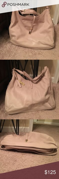 Vince Camuto leather bag Beige/cremish/nudish clay color leather hobo type bag. Supercute. Inside is impeccable and the outside is in excellent condition except for a pen mark near the front slide closure Bags Hobos