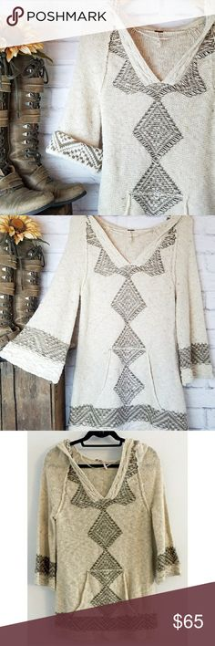 """Free People • Hooded Boho Sweater Beautiful oatmeal colored sweater with yellow flecks of color and chocolate brown design. Thick knit with hood and kangaroo pocket, flared sleeves. Perfect for fall!  • Approx 18"""" armpit to armpit  • Approx 31"""" length  Excellent gently preloved condition with no rips, holes or stains. MAY be a snag here and there. As is.   No holds, trades or off-posh transactions. Free People Sweaters V-Necks"""