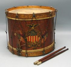 "*MILITIA ~ New York, Civil War period drum, bird's-eye maple snare drum with hand-painted shield and trophy motif with paint decorated rims. Interior of body presents ""Sempf & Ottes, 209/211 Grand St., New York: makers label, sold w/ 14"" pair of nickel capped drumsticks, c.1861-1865"