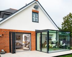 A glass box extension was installed to this new build home including minimal windows® sliding doors. The structural glass roof and structural glass walls allow light to flood into the home. House Extension Design, Glass Extension, House Design, Extension Ideas, Modern Conservatory, Glass Conservatory, Conservatory Extension, Garden Room Extensions, House Extensions