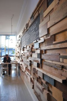 Slowpoke-CAFE (Melbourne) - | sasufi.net. I love the offcut timber wall which adds warmth to the design + has some sections that stick out to create shelves above tables.