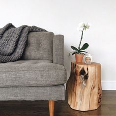 Simple, clean, and stylish. Tree stump end table lends a touch of natural elements in the room which I love