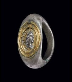 A Roman silver and gold finger ring. Circa 2nd century AD